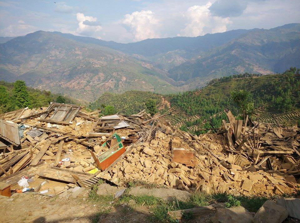 houses  overlooking a valley broken doen to rubbles with the massive earthquake in nepal